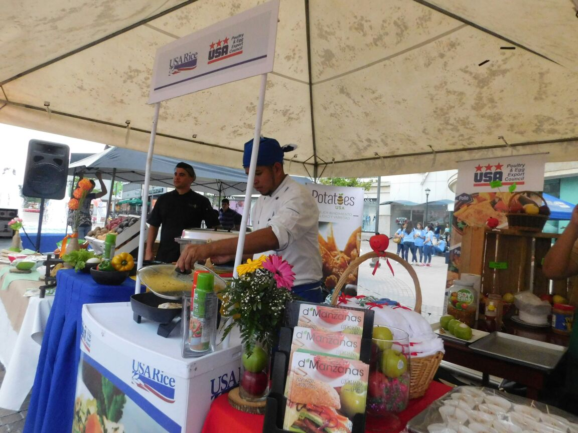 Chef cooks up rice at the USA Rice booth in Guatemala