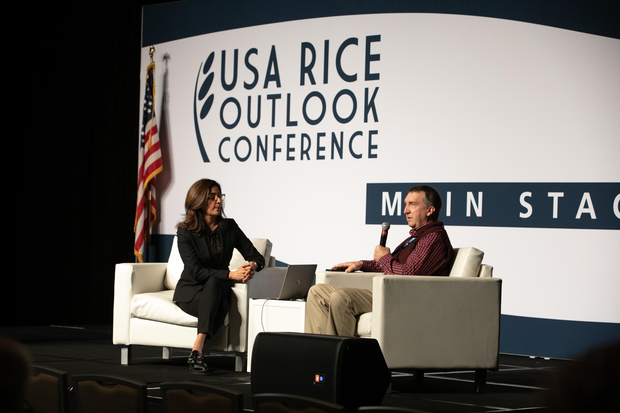 Keynote speaker Dr. Shimi Kang talking stress with Arkansas farmer Mike Sullivan