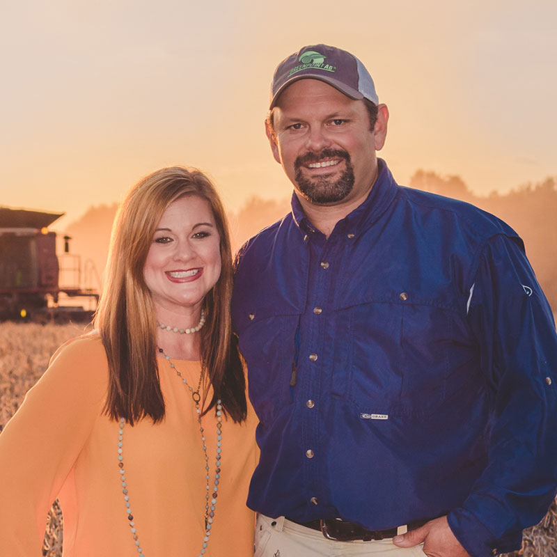 Rice farmer Jason Waller standing with his wife in a field.