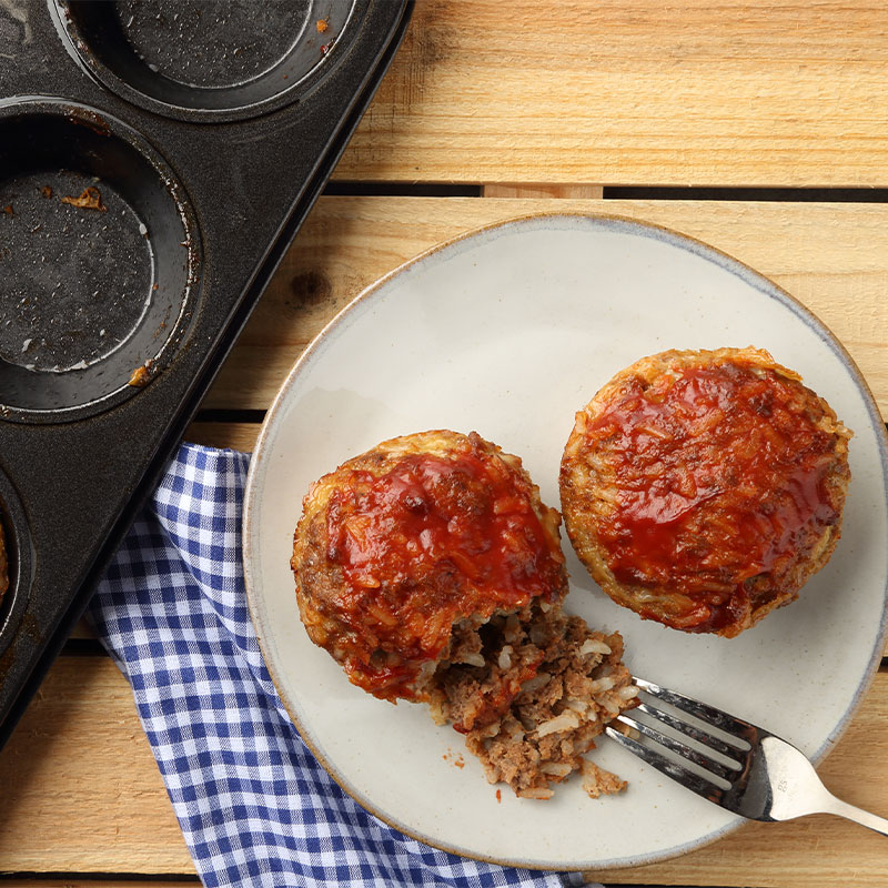 Two BBQ Muffin Rounds on a white plate.