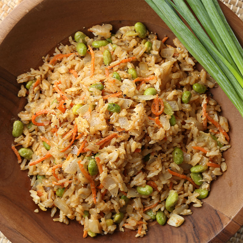 Overhead view of Fried Rice Stir Up with green onions talks to the side.