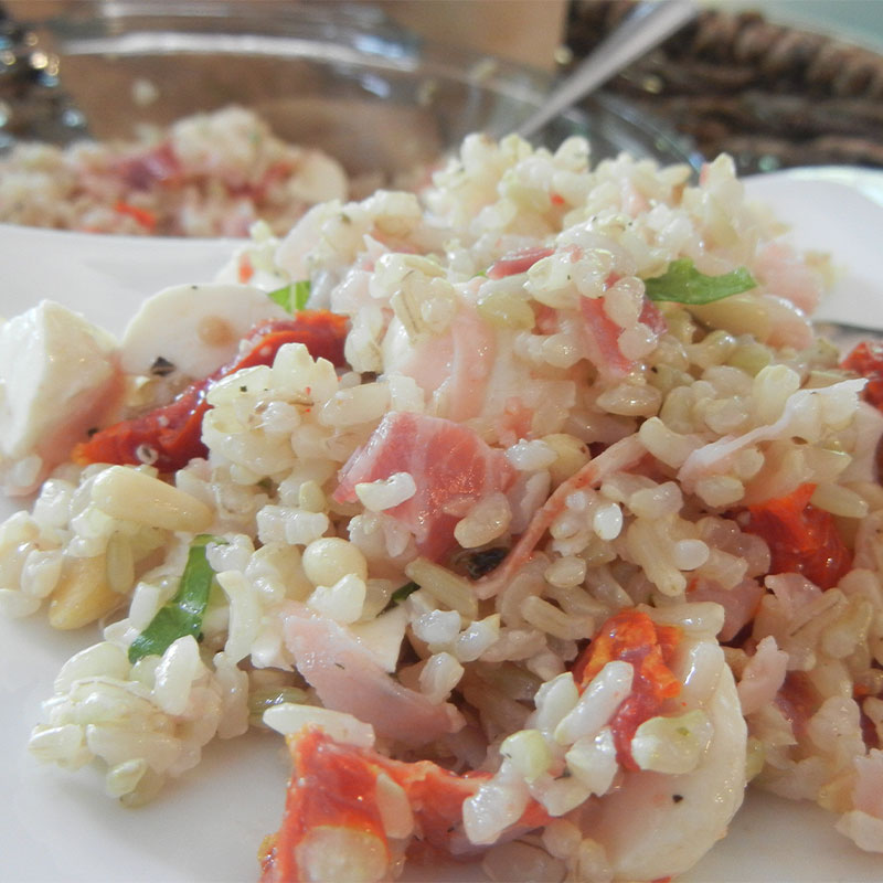 A zoomed in shot of a spoonful of Italian Brown Rice Salad.