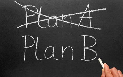 Plan A (crossed out) and Plan B written on chalkboard