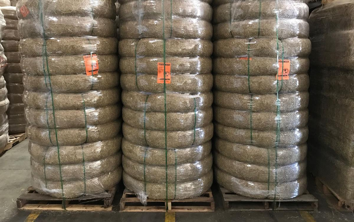 Rice-wattles-stacked on-pallets, wrapped in plastic