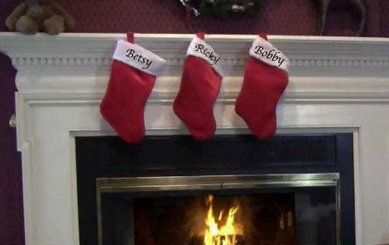 Christmas stockings hung above fireplace