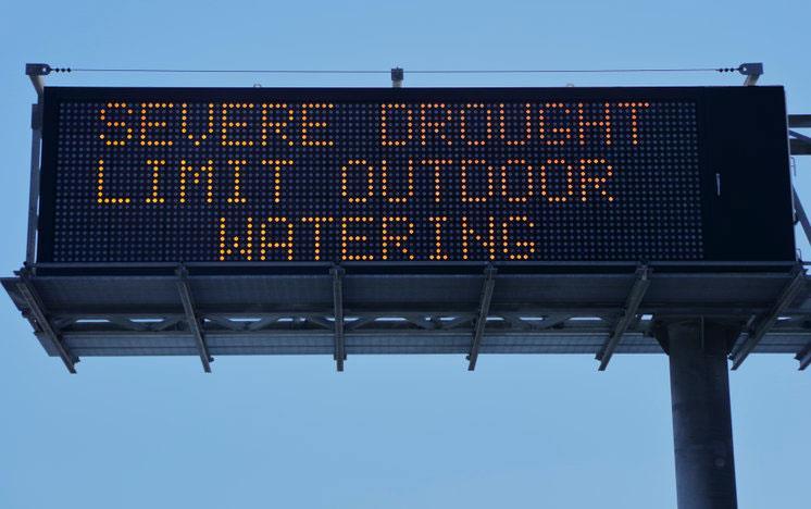 Digital billboard text: Severe Drought Limit Outdoor Watering