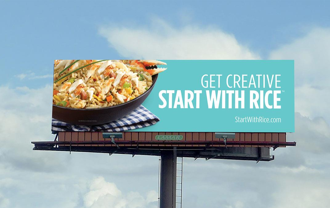 """Billboard shows rice dish on blue background with text """"Get Creative Start With Rice"""""""