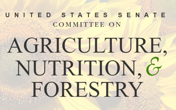 Senate Ag Committee text superimposed over photo of sunflowers