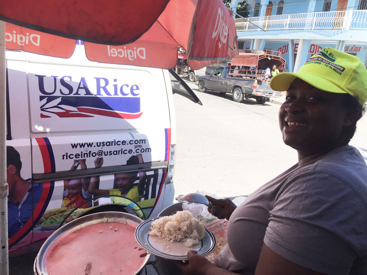 Woman dishes up white rice at USA Rice food truck