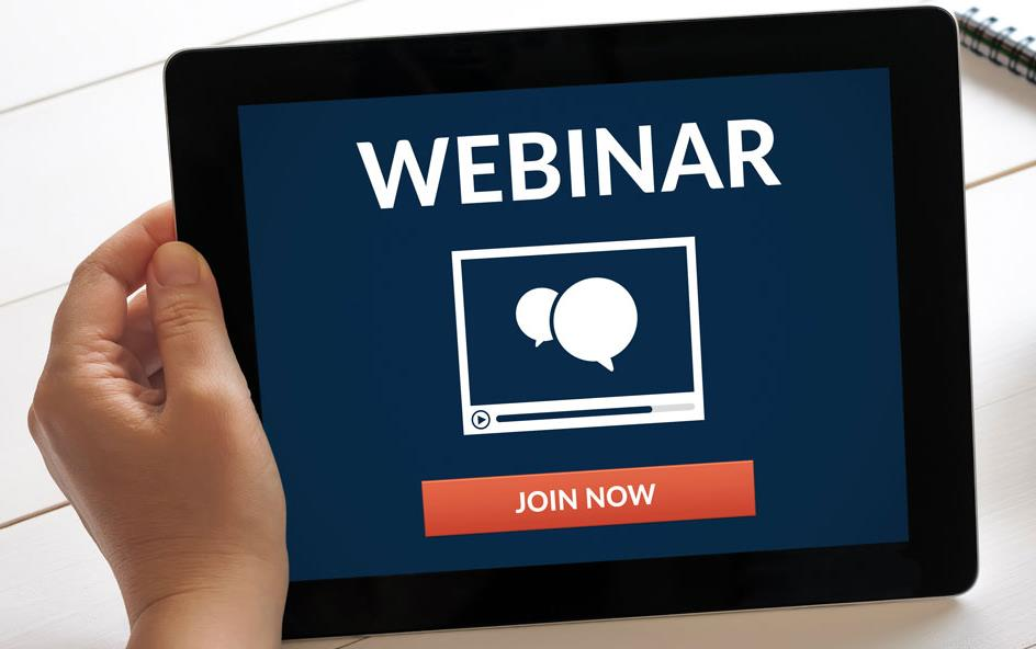 """Hand holds iPad announcing """"webinar, join now"""""""