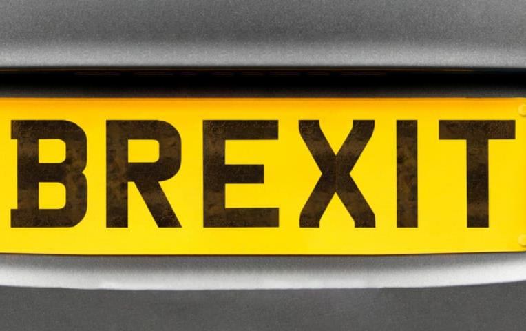 License plate that says BREXIT in black letters on yellow background