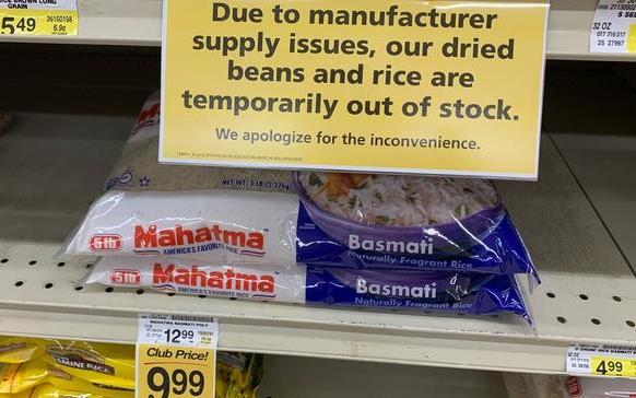 Two bags of rice on near-empty grocery store shelves