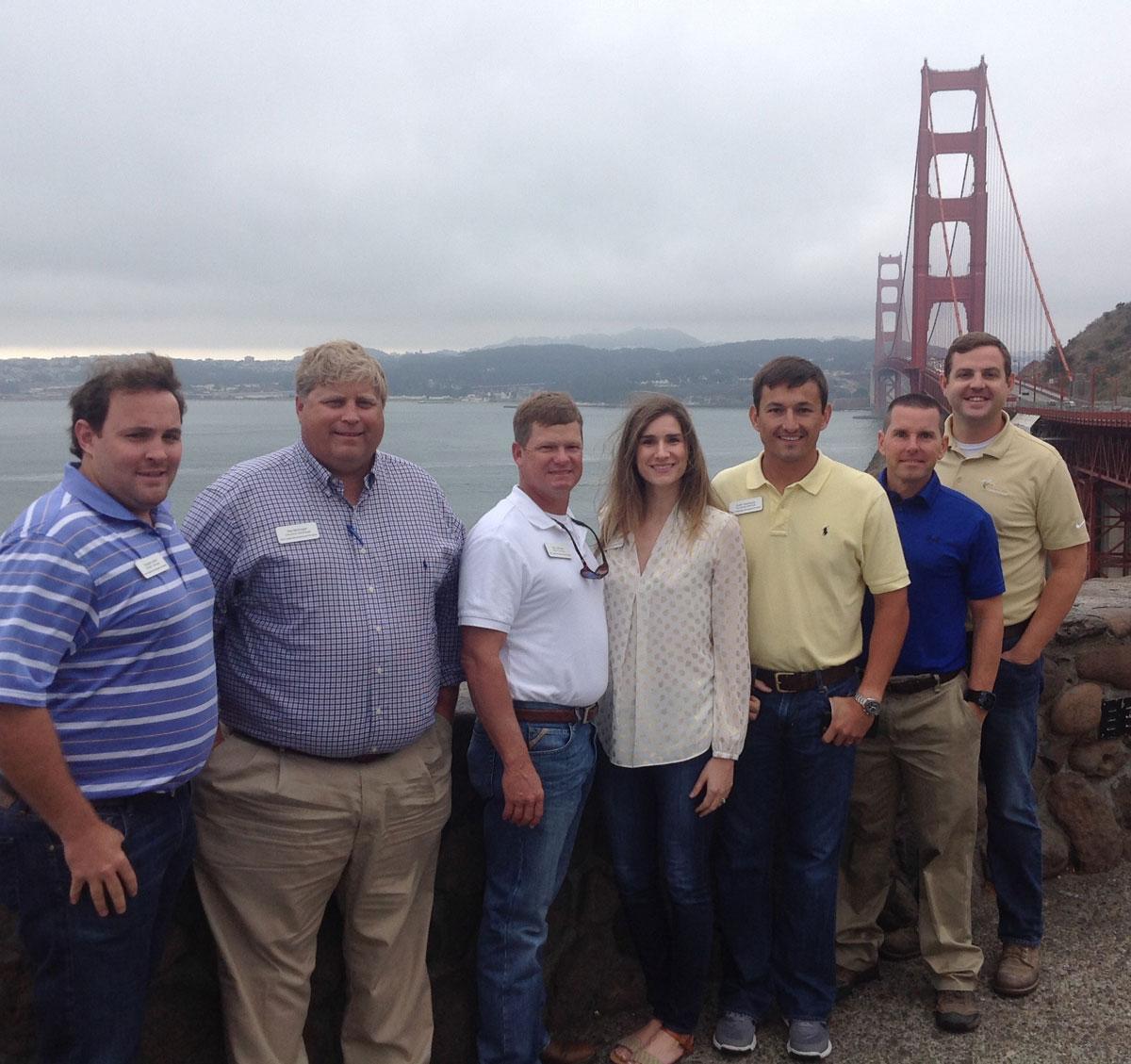 Group shot of people standing near the San Francisco Golden Gate Bridge