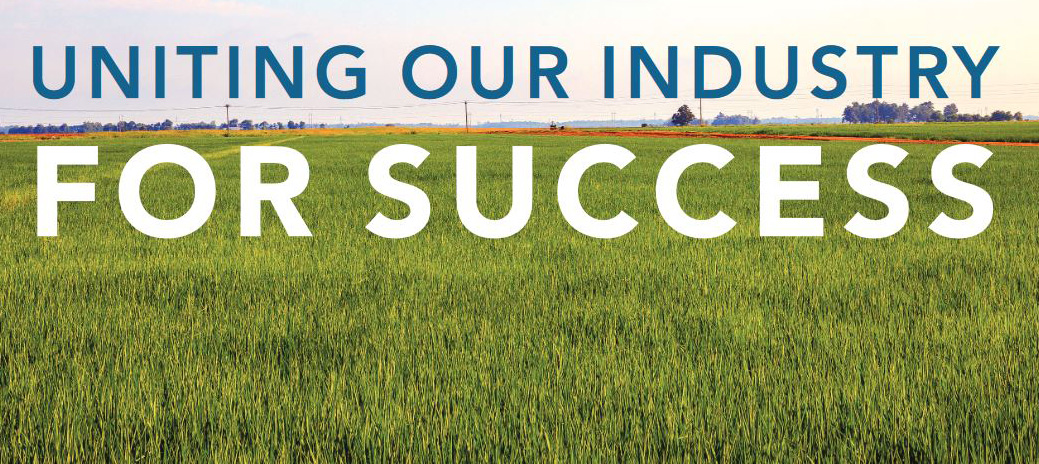 """Text reading """"Uniting-Our-Industry-For-Success"""" superimposed on green rice field"""