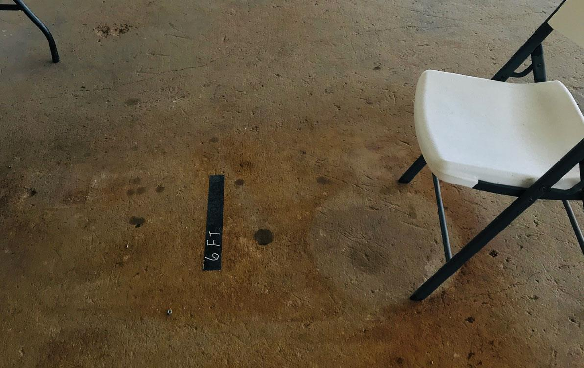 Whiate fold-out chairs set 6 feet apart for social distancing