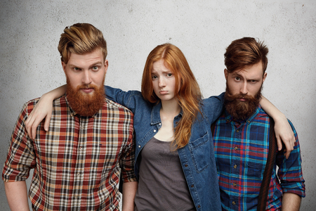 Three skeptical millenial hipsters
