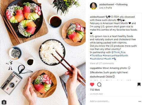 Instagram-post for Heart-Health-Month-Campaign with ingredients for sushi donuts displayed on white table: bowl of rice, colorful veggies & an instamatic camera