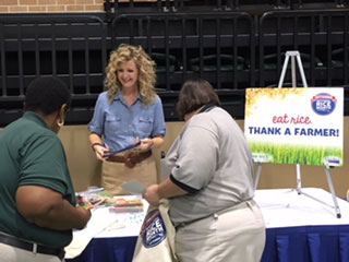 2016-Delta-Rice-Luncheon, Carrie Castille talks with visitors at booth