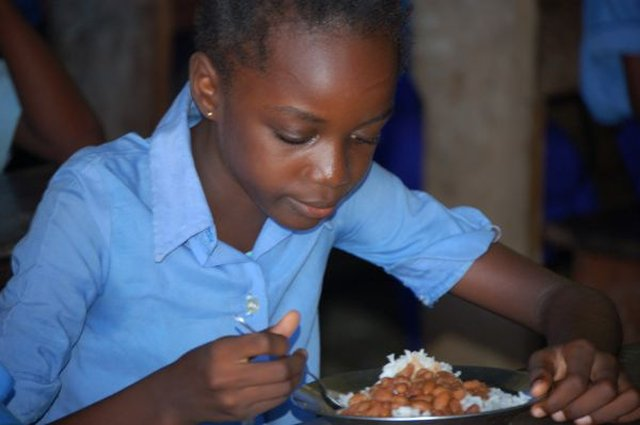 Image of a Girl Eating Rice