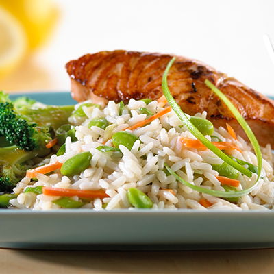 White rice on a plate with salmon and broccoli