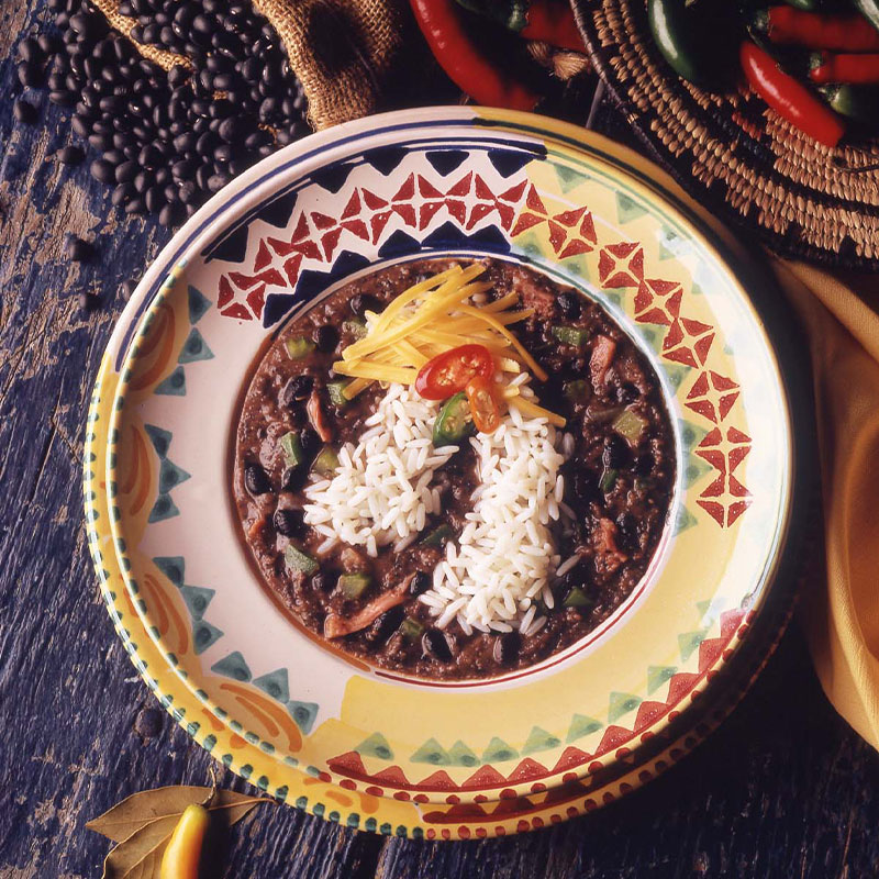 Overhead shot of Black Bean Soup with Rice in a colorful bowl.