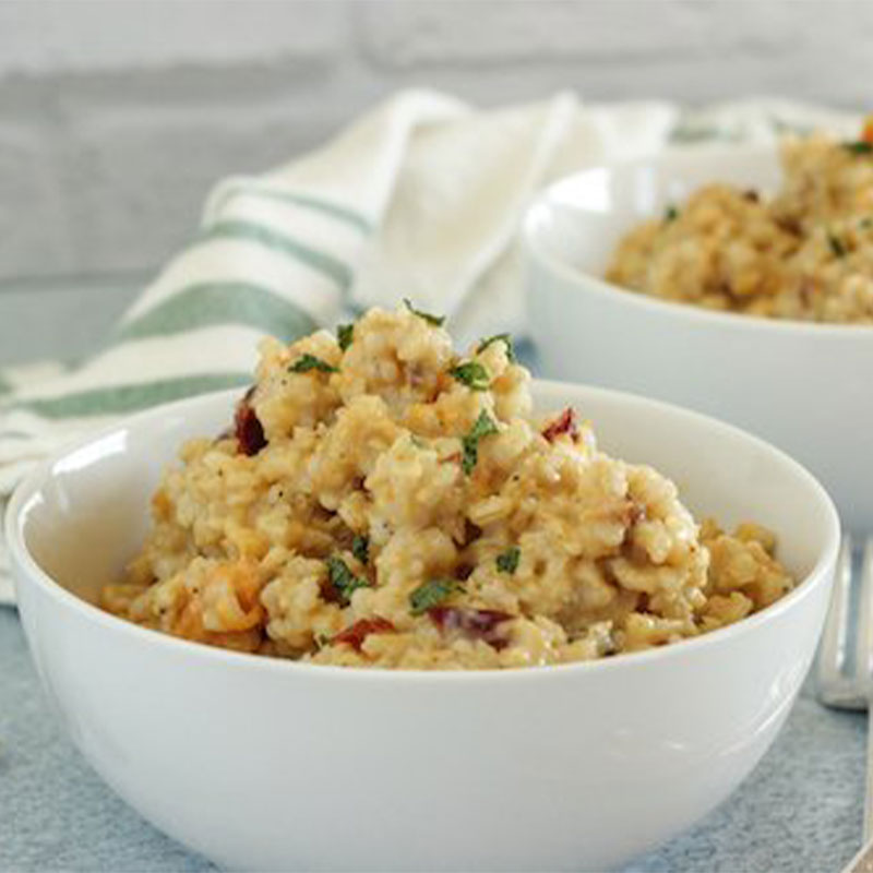 Side view of two white bowls filled with Risotto mix.
