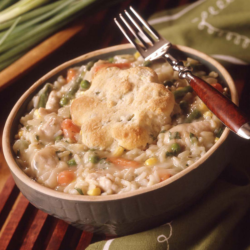 Side view of chicken pot pie with rice in a bowl.