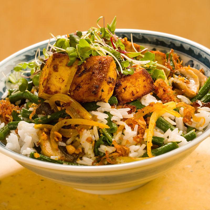 Close up view of lemongrass tofu rice bowl.