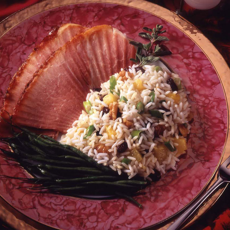 Overhead view of pineapple rice pilaf with ham and green beans.