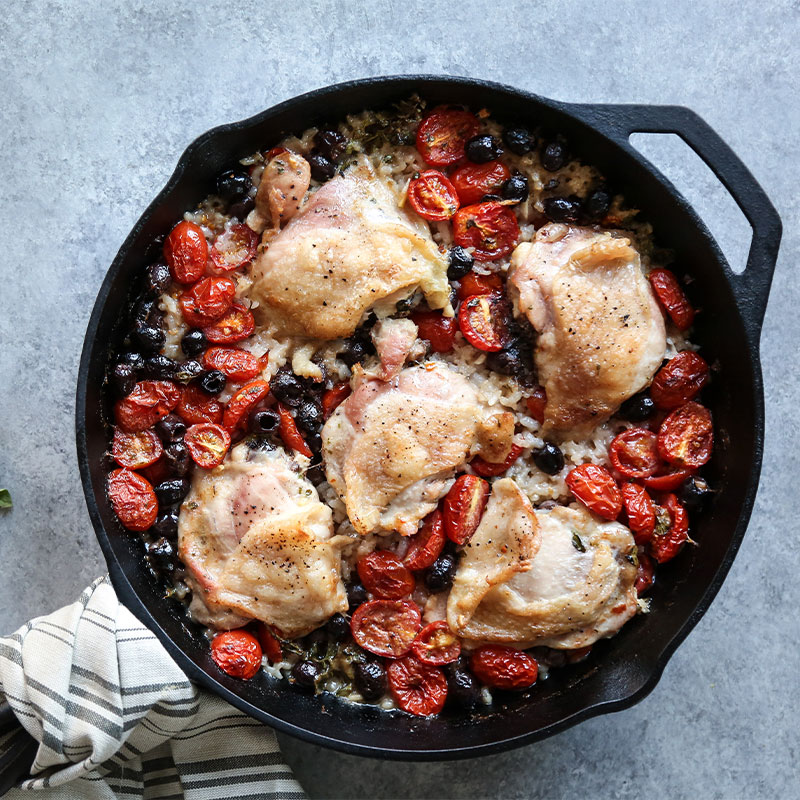 Overhead view of Baked Provencal Chicken and Rice Casserole in a skillet.