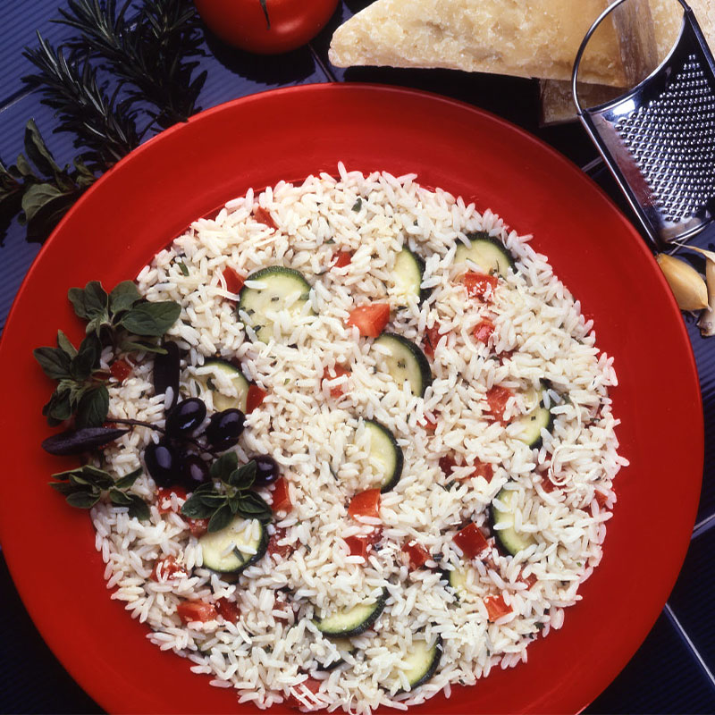 Overhead shot view of Rice Salad Milano in a red bowl.
