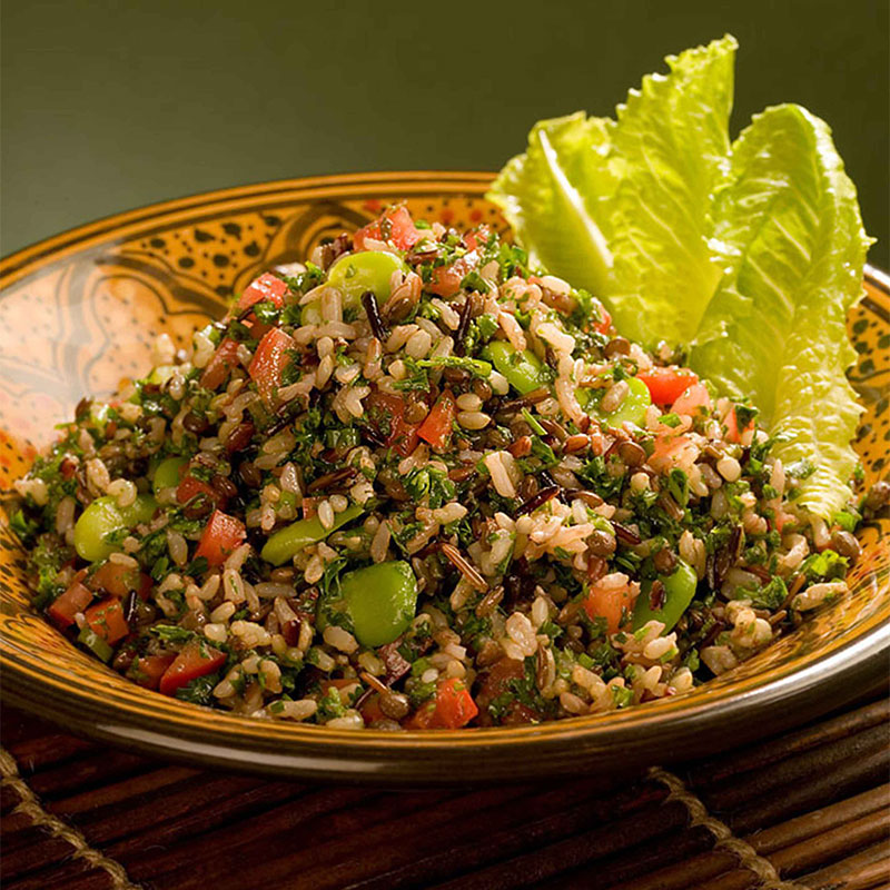Seven-Rice Tabbouleh Salad neatly plated with crisp lettuce leaves on the side.