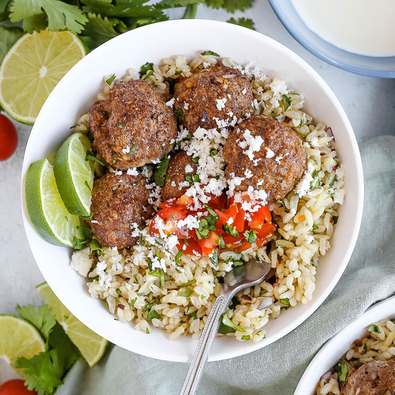 Overhead view of a bowl of Smoky Chipotle Meatballs with Cilantro Lime Rice.
