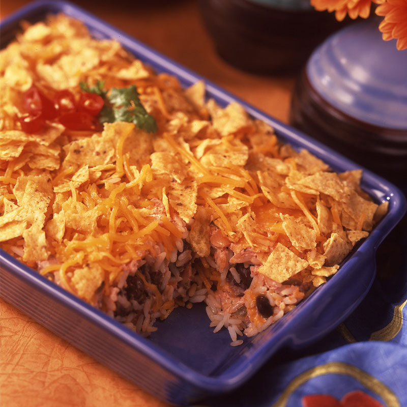 Side view of south-of-the-border lasagna in a blue casserole dish.