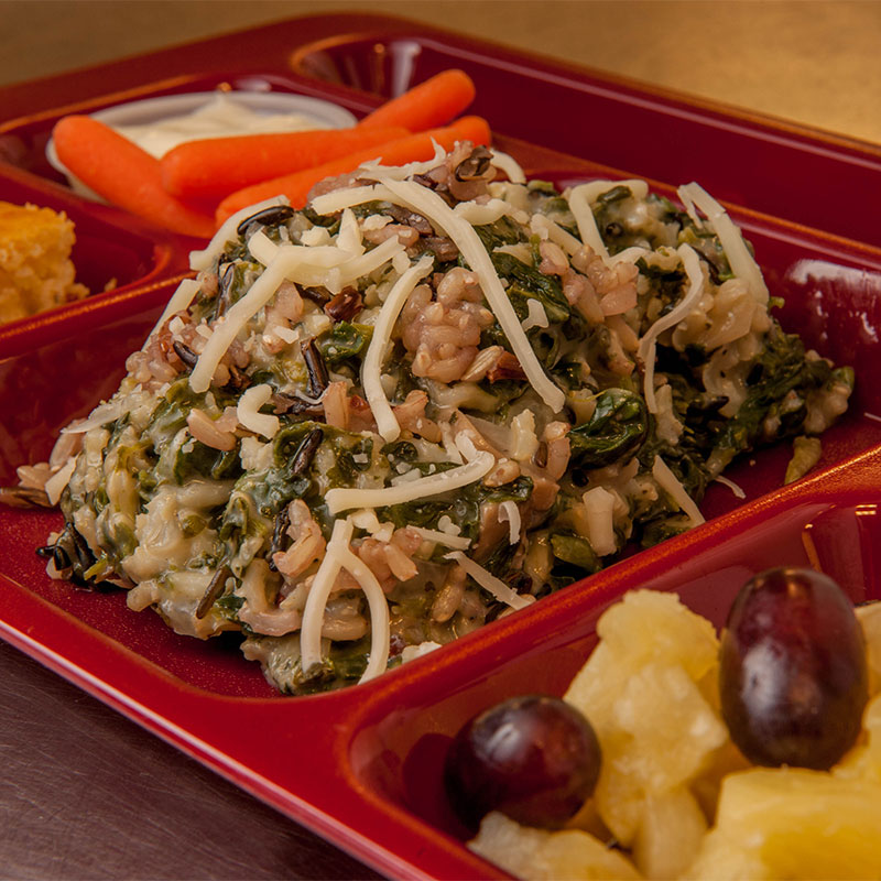 A serving of Spinach and Rice Rumble on a red cafeteria tray.