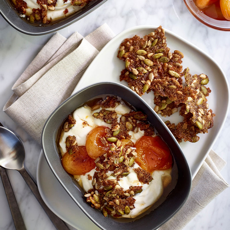 Overhead image of Sweet and Salty Brown Rice Granola on a white plate.