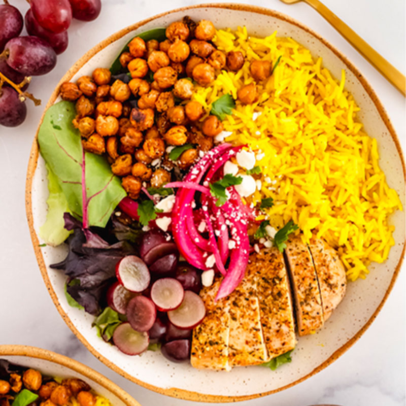 Overhead view of a very colorful Turmeric Coconut Basmati Rice Bowl.