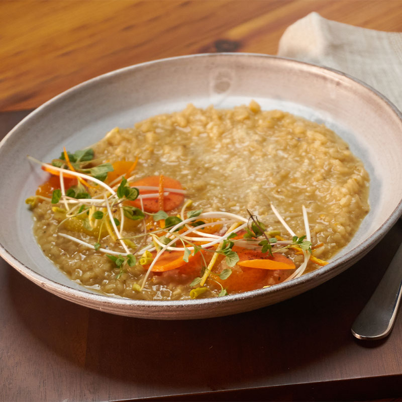 Overhead view of a bowl of Winter Citrus Risotto.