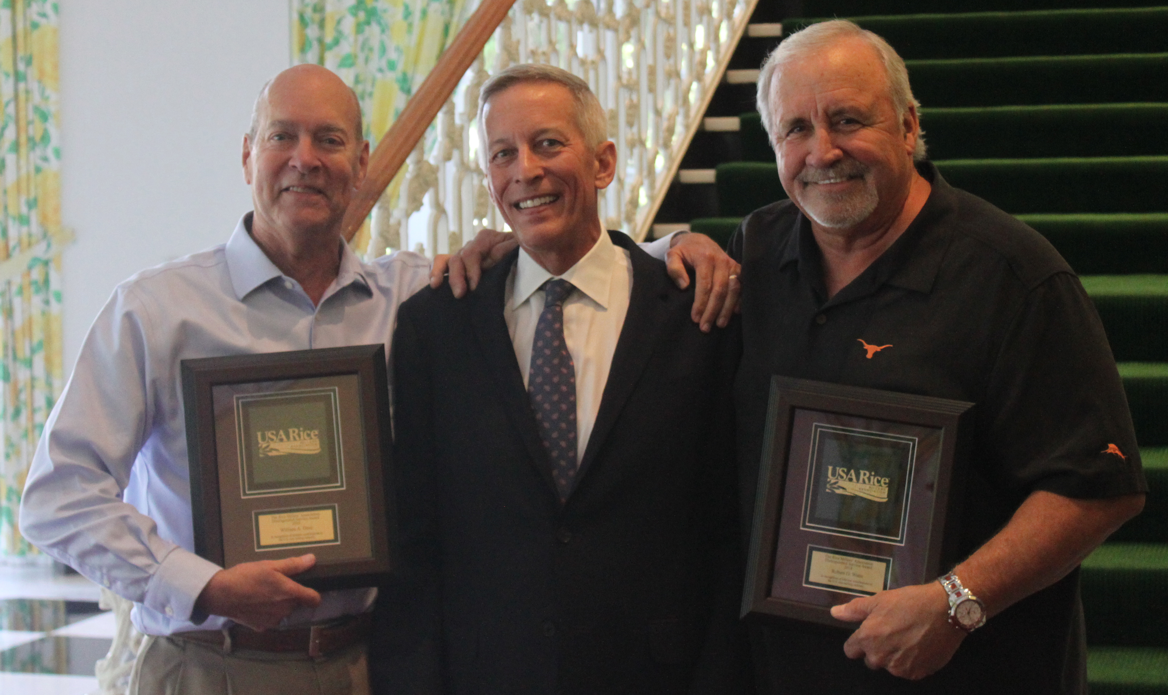 KBX, Inc. President Steven Keith presents Distinguished Service Awards to two RMA members:  Bill Dore (left) and Bob Watts (right)