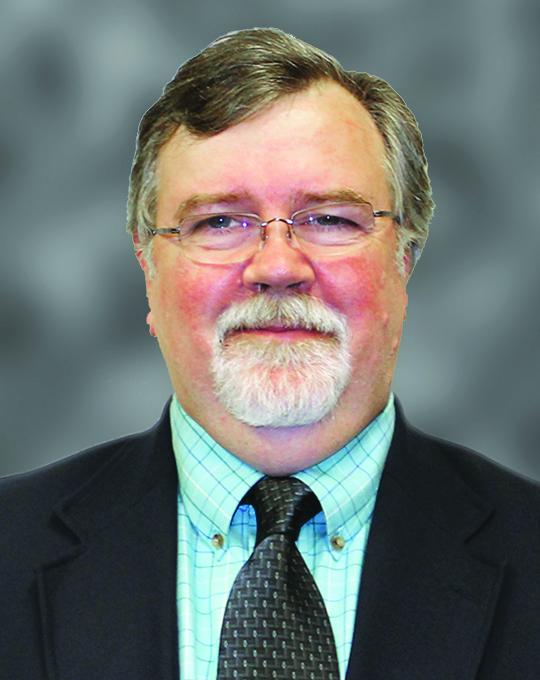Dr. Ralph Dean, headshot, older white man with white goatee and glasses wearing suit and tie