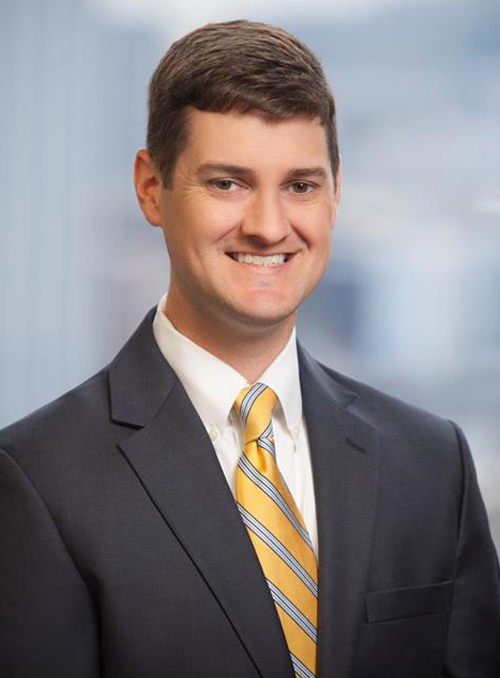 Young white male wearing business suit & tie, headshot