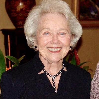 Agnes Godchaux, attractive older white woman with white hair, wearing black blouse and black pearl jewelry