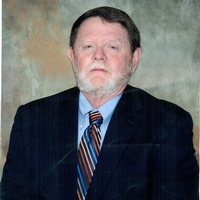 Jimmy Richard, white man in dark suit with dark hair and a white beard