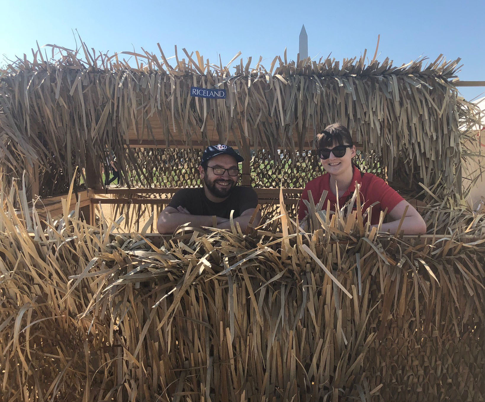Riceland Duck Blind, two people amidst rice stalks that camouflage shooting gallery