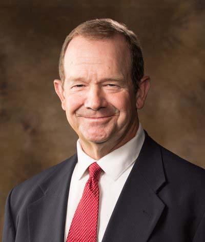 Terry Siebenmorgen, headshot, white man wearing dark business suit and red tie