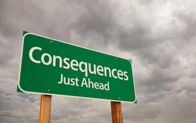 Green highway sign that says:  Consequences Just Ahead