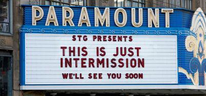 "Theater marquee says ""This Is Just Intermission, We"