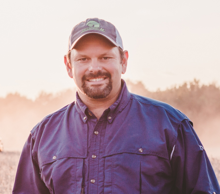 LA rice farmer Jason Waller, headshot, white man with mustache and goatee wearing blue button-down shirt and baseball cap,