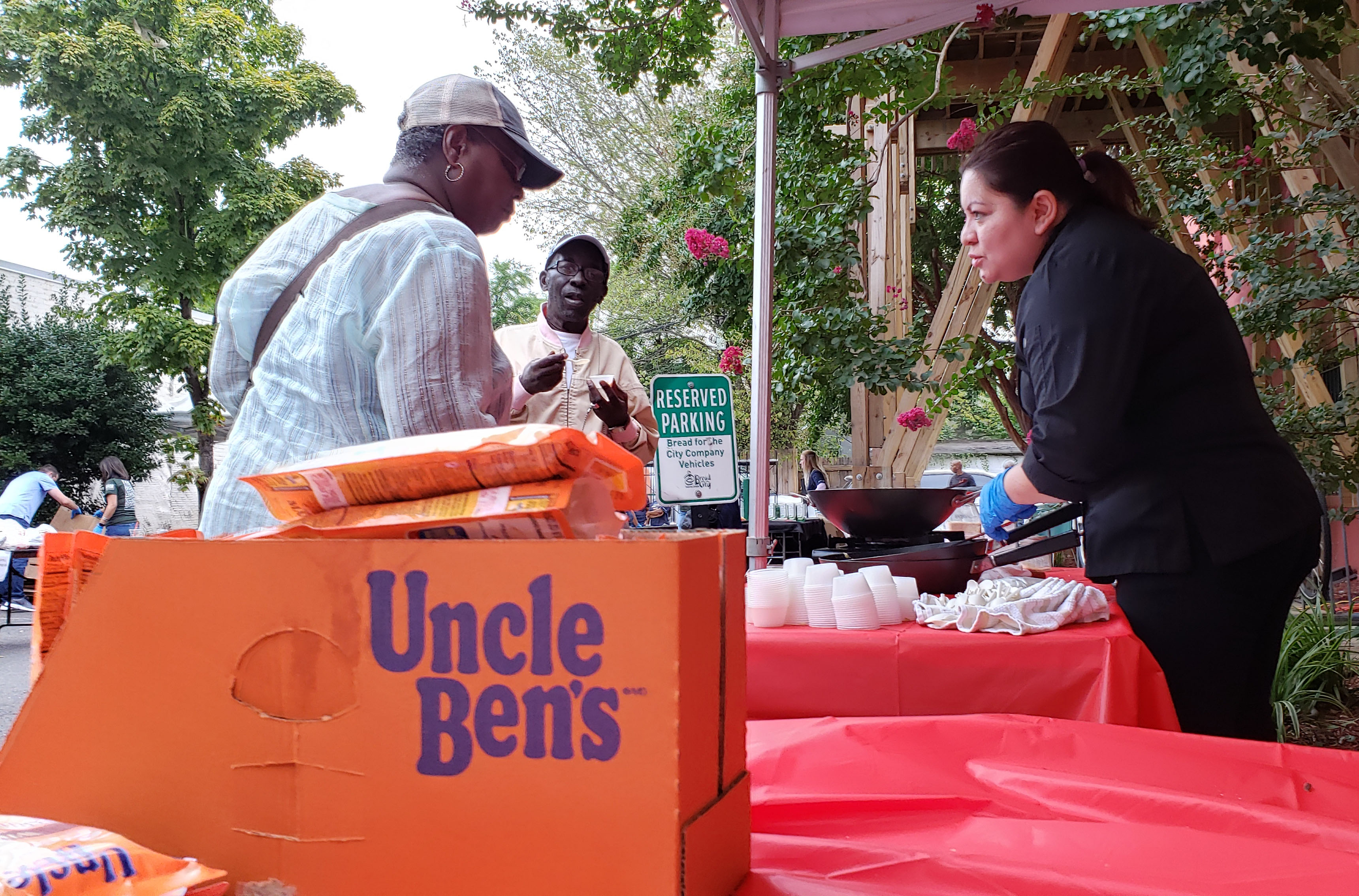 Female chef serves Uncle Ben