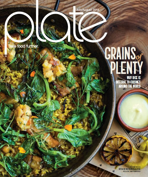 Magazine cover photo shows overhead shot of rice and vegetable dish in black bowl with a scorched lemon half and yellow peppers alongside